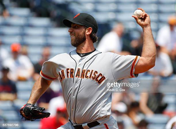 Madison Bumgarner of the San Francisco Giants pitches in the third inning against the Atlanta Braves at Turner Field on June 2 2016 in Atlanta Georgia