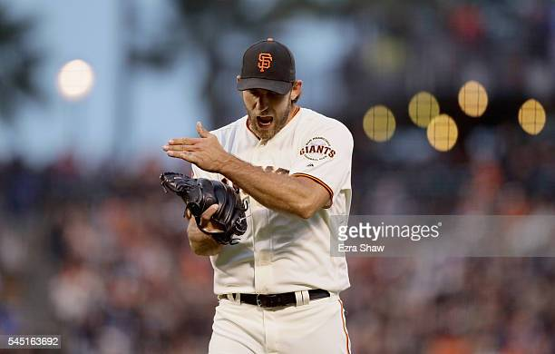 Madison Bumgarner of the San Francisco Giants reacts after Mac Williamson of the San Francisco Giants caught a fly ball hit by Trevor Story of the...