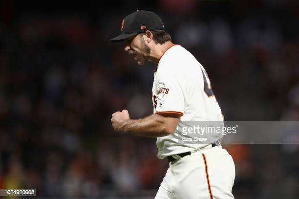 Madison Bumgarner of the San Francisco Giants reacts after the Giants got the final out of the sixth inning in which the Arizona Diamondbacks had the...