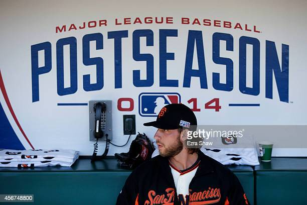 Madison Bumgarner of the San Francisco Giants sits in the dugout prior to Game Three of the National League Division Series against the Washington...
