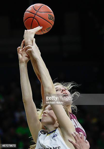 Madison Cable of the Notre Dame Fighting Irish and Maggie Rickman of the Montana Lady Grizzlies battle for a rebound during the first round of the...