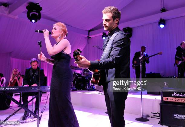 Madison Cain and Miles Schon perform at the wedding of Michaele Schon and Neal Schon at the Palace of Fine Arts on December 15 2013 in San Francisco...