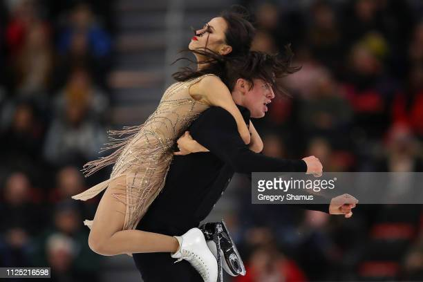 Madison Chock and Evan Bates compete in the championship free dance during the 2019 US Figure Skating Championships at Little Caesars Arena on...