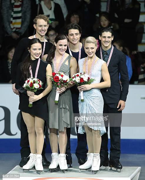 Madison Chock and Evan Bates of the United States pose with their silver medals as Tessa Virtue and Scott Moir of Canada pose with their gold medals...
