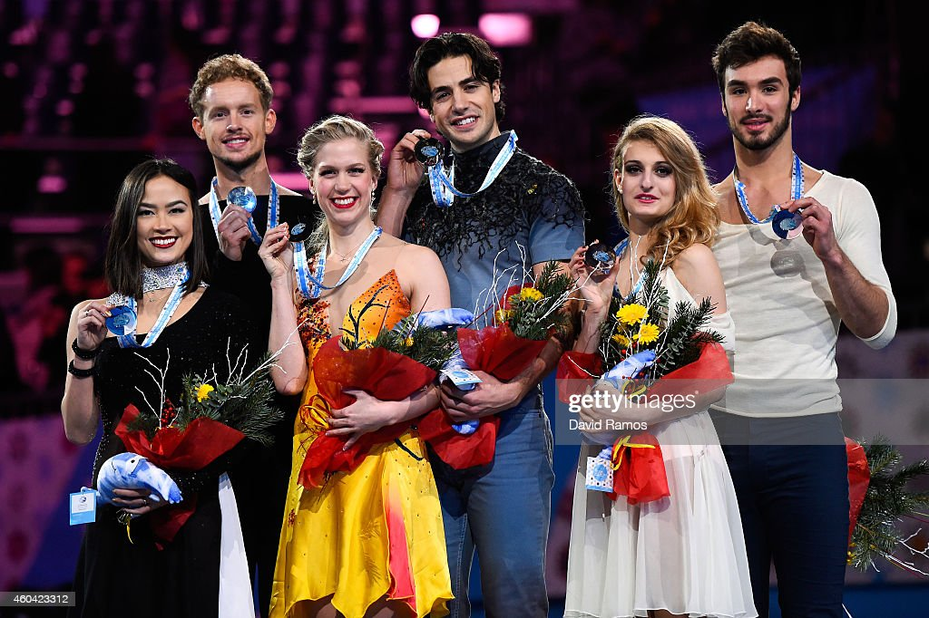 Madison Chock and Evan Bates of USA, Kaitlyn Weaver and Andrew Poje of Canada and Gabriella Papadakis and Guillaume Cizeron of France pose for the media during the medals ceremony during day three of the ISU Grand Prix of Figure Skating Final 2014/2015 at Barcelona International Convention Centre on December 13, 2014 in Barcelona, Spain.