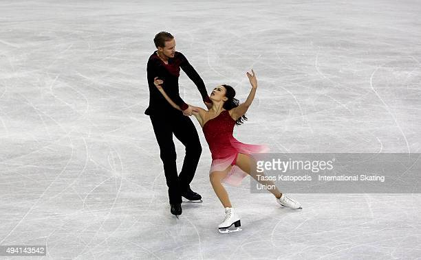 Madison Chock and Evan Bates of USA skates during the ice dance on October 24 2015 in Milwaukee Wisconsin
