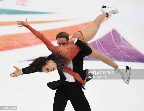 Madison Chock and her partner Evan Bates of the USA compete before scoring the second highest points in the Ice Dance Rhythm Dance competition during...