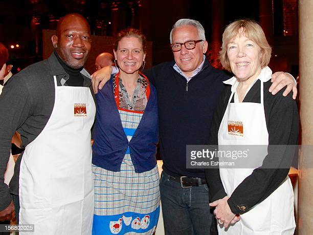 Madison Cowan Amanda Freitag Geoffrey Zakarian and Brooke Bailey Johnson volunteer during the Our Table Is Yours A Thanksgiving Day benefit at...