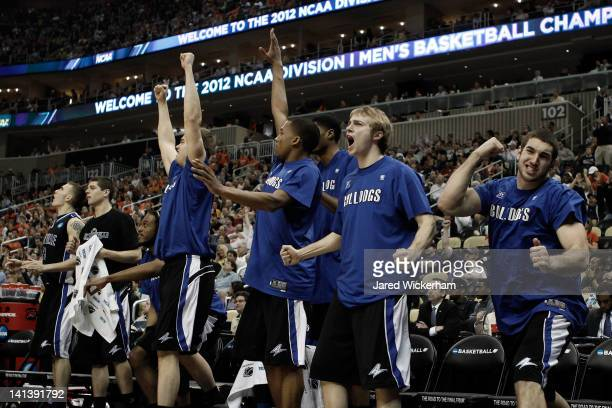 Madison Davis of the UNC Asheville Bulldogs and his teammates celebrate after a play against the Syracuse Orange during the second round of the 2012...