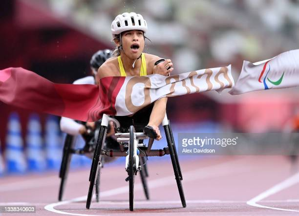 Madison de Rozario fo Team Australia crosses the finish line to win the women's Marathon - T54 on day 12 of the Tokyo 2020 Paralympic Games at...