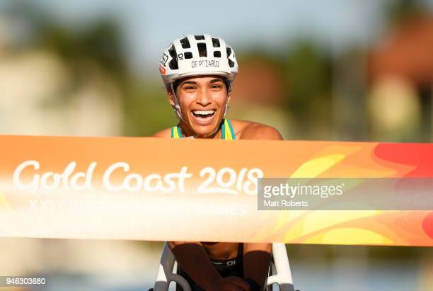 Madison de Rozario of Australia crosses the line to win gold in the Women's T54 marathon on day 11 of the Gold Coast 2018 Commonwealth Games at...