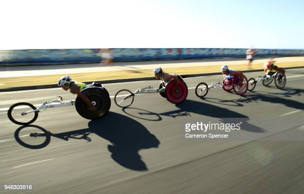 Madison de Rozario of Australia leads the pack during the Men's and Women's T54 marathon on day 11 of the Gold Coast 2018 Commonwealth Games at...