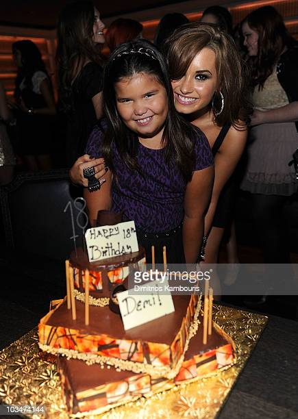 Madison DeLaGarza and Demi Lovato with birthday cake at Demi Lovato's 18th birthday party at Buddakan on August 19 2010 in New York City