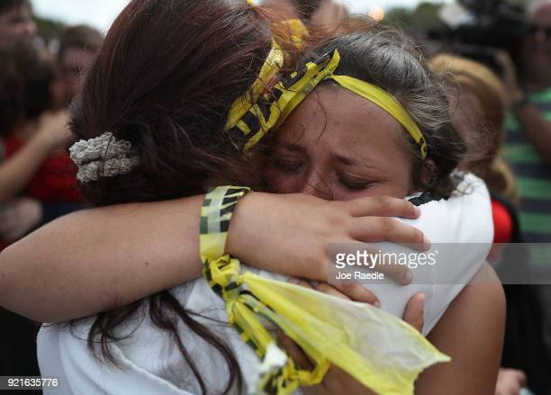 Madison Fox is hugged as the West Boca High School student joined hundreds of fellow students that walked to Marjory Stoneman Douglas High School in...