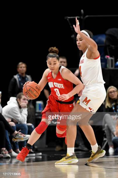 Madison Greene of the Ohio State Buckeyes handles the ball against Stephanie Jones of the Maryland Terrapins during the Championship game of Big Ten...