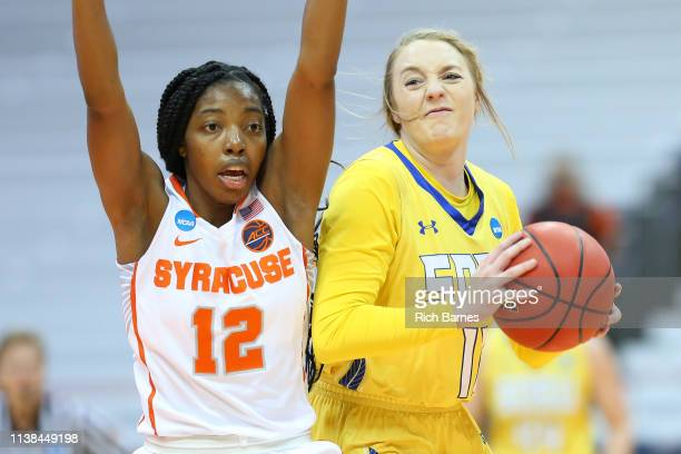 Madison Guebert of the South Dakota State Jackrabbits looks to shoot the ball as Kiara Lewis of the Syracuse Orange defends during the first half in...