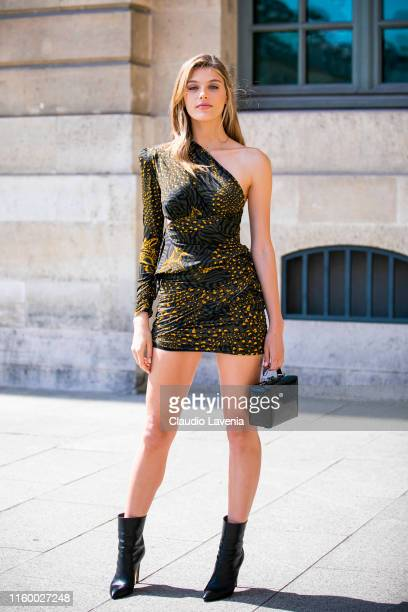 Madison Headrick wearing a printed mini dress black boots and black bag is seen outside Dundas show during Paris Fashion Week Haute Couture...
