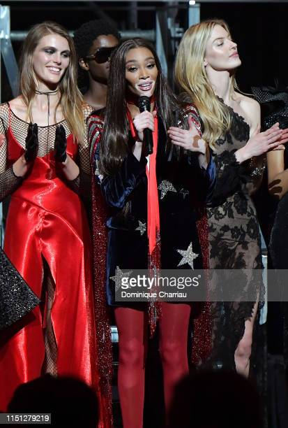Madison Headrick Winnie Harlow and Martha Hunt speak on stage during the amfAR Cannes Gala 2019 at Hotel du CapEdenRoc on May 23 2019 in Cap...