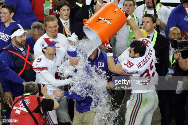 Madison Hedgecock of the New York Giants dumps Gatorade on head coach Tom Coughlin after the Giants defeated the New England Patriots 17-14 during...