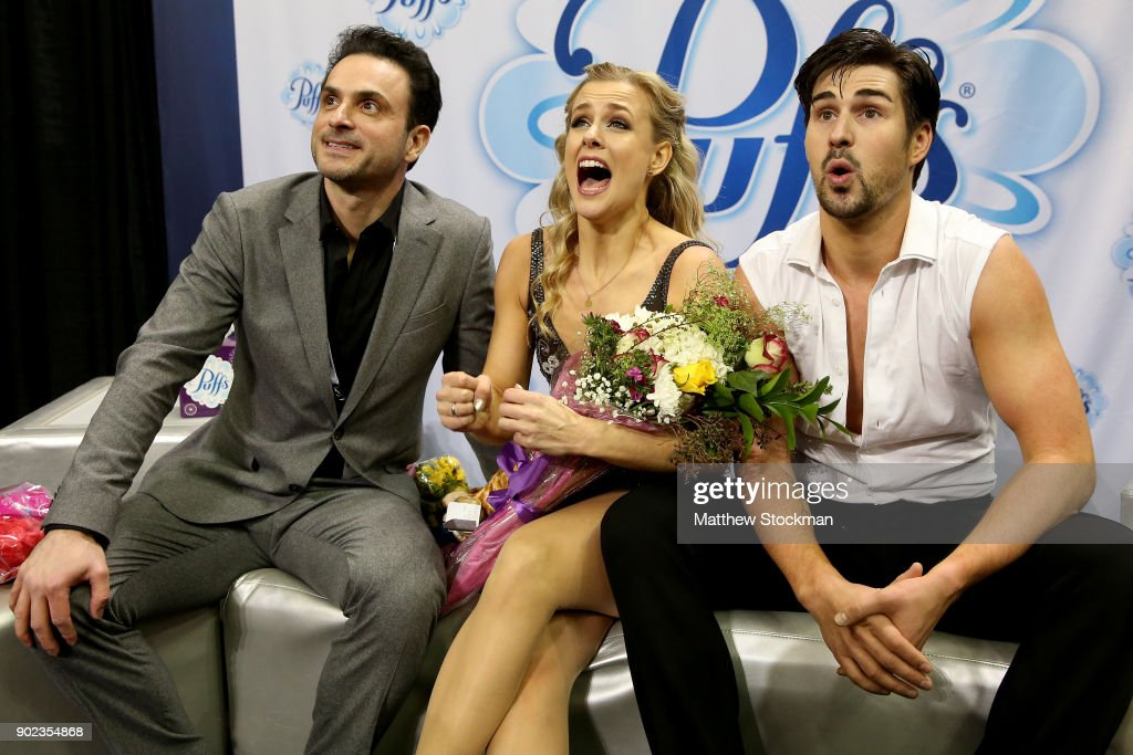 Madison Hubbell and Zachary Donohue celebrate in the kiss and cry with their coach Patrice Lauzon after skating in the Free Dance during the 2018 Prudential U.S. Figure Skating Championships at the SAP Center on January 7, 2018 in San Jose, California.