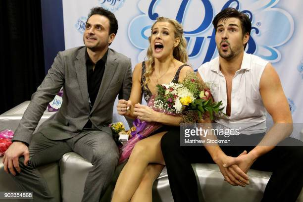 Madison Hubbell and Zachary Donohue celebrate in the kiss and cry with their coach Patrice Lauzon after skating in the Free Dance during the 2018...