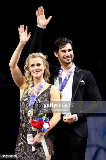 Madison Hubbell and Zachary Donohue celebrate on the medals podium for the Championship Dance during the 2018 Prudential US Figure Skating...