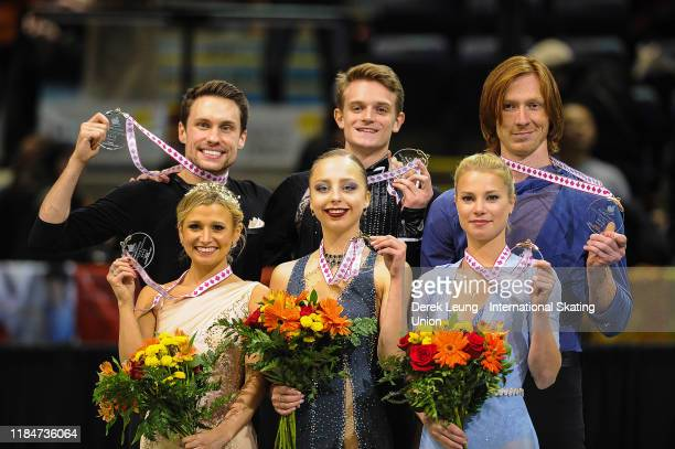 Madison Hubbell and Zachary Donohue of USA, Piper Gilles and Paul Poirier of Canada, and Lilah Fear and Lewis Gibson of Great Britain receive their...
