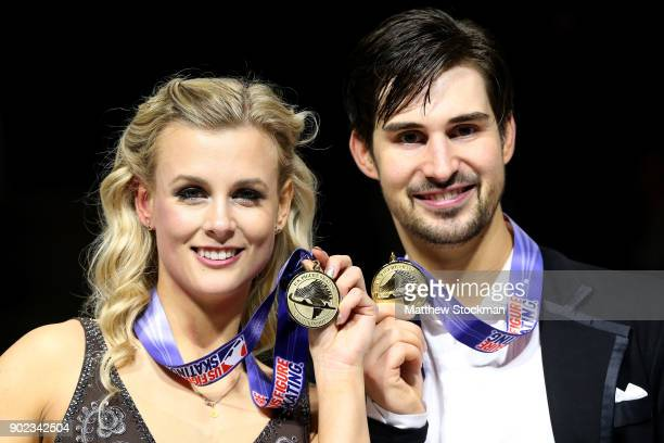 Madison Hubbell and Zachary Donohue pose for photographers after the medal ceremony for the Championship Dance during the 2018 Prudential US Figure...