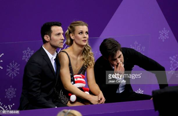Madison Hubell and Zachary Donohue of USA with their coach Romain Hagenauer react with disappointment at 'kiss and cry' during the Figure Skating Ice...