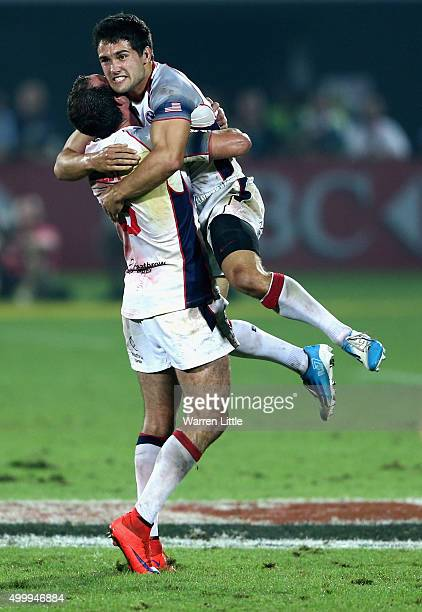 Madison Hughes of the USA celebrates with team mate Zack Test after kicking the winning points to beat New Zealand during the Emirates Dubai Rugby...