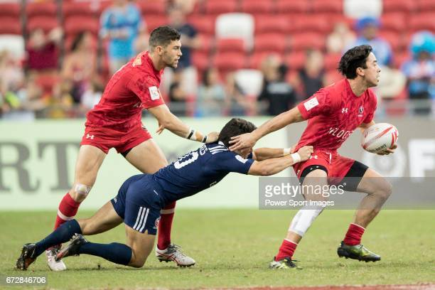 Madison Hughes of USA tries to tackle Nathan Hirayama of Canada who runs with the ball during the match United States vs Canada the Cup Final of the...