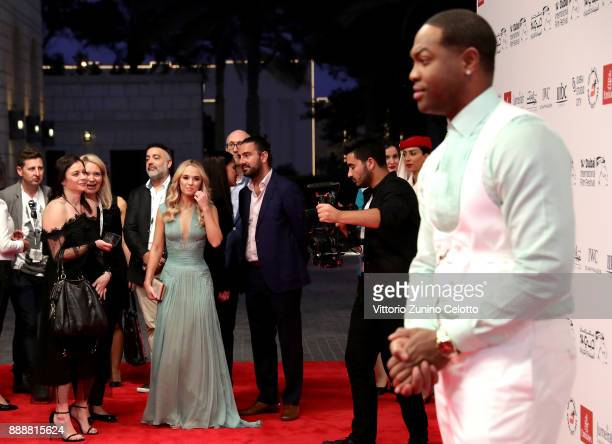 Madison Iseman and Ser Darius Blain attend the Jumanji Welcome to the Jungle on day four of the 14th annual Dubai International Film Festival held at...