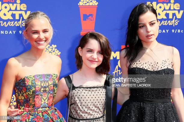Madison Iseman Mckenna Grace and Katie Sarife arrive for the 2019 MTV Movie TV Awards at the Barker Hangar in Santa Monica on June 15 2019 The 2019...