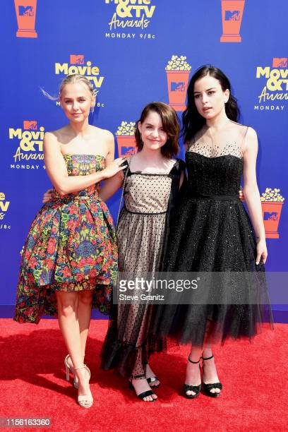 Madison Iseman Mckenna Grace and Katie Sarife attend the 2019 MTV Movie and TV Awards at Barker Hangar on June 15 2019 in Santa Monica California