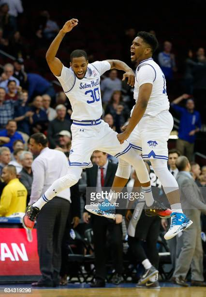 Madison Jones and Myles Powell of the Seton Hall Pirates celebrate after defeating the Providence Friars 7270 in overtime of an NCAA college...