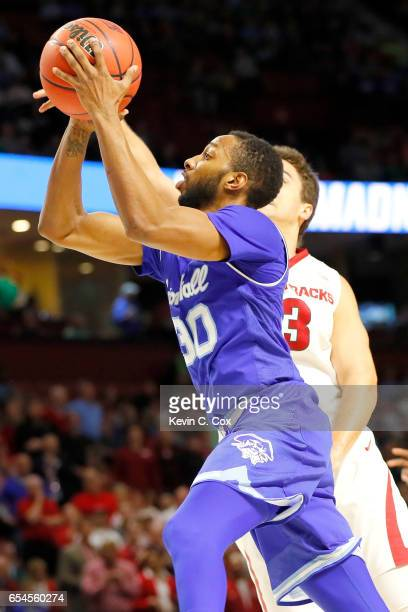 Madison Jones of the Seton Hall Pirates shoots against Dusty Hannahs of the Arkansas Razorbacks in the second half in the first round of the 2017...