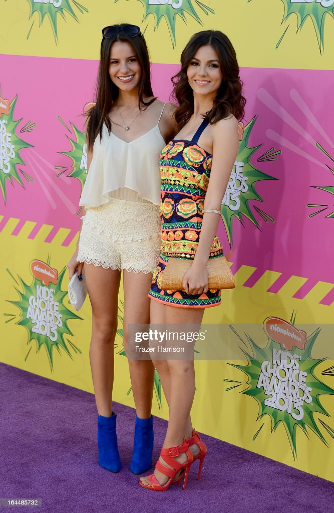 Madison Justice (L) and actress Victoria Justice arrive at Nickelodeon's 26th Annual Kids' Choice Awards at USC Galen Center on March 23, 2013 in Los Angeles, California.