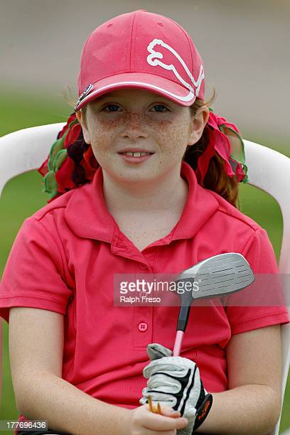 Madison Kerr waits for her tee time in the Girl's 79 Division during a regional round of the Drive Chip Putt Championships on August 25 2013 in...