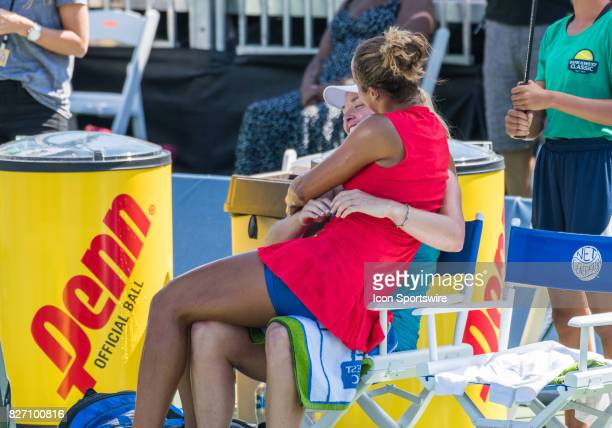 Madison Keys gives CoCo Vandeweghe a hug after the match at the WTA singles championship round at the Bank of the West Classic between at the Taube...