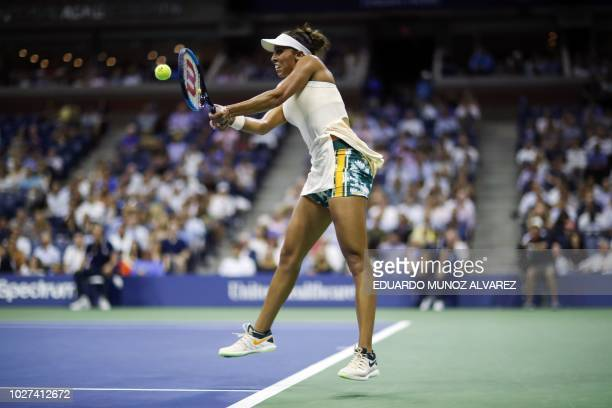 US Madison Keys hits a return to Spain's Carla Suarez Navarro during their Women's Singles QuarterFinals match at the 2018 US Open at the USTA Billie...