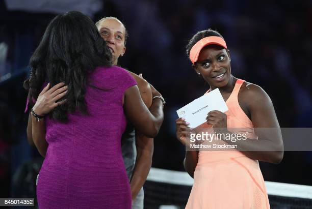 Madison Keys of the United States and Sloane Stephens of the United States pose during the trophy presentation after the Women's Singles finals match...