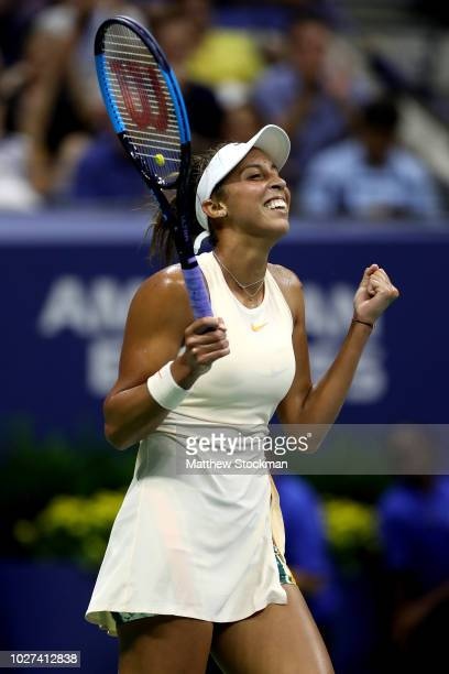 Madison Keys of the United States celebrates after winning her women's singles quarterfinal match against Carla Suarez Navarro of Spain on Day Ten of...
