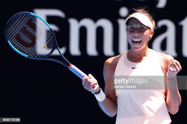 Madison Keys of the United States celebrates winning her fourth round match against Caroline Garcia of France on day eight of the 2018 Australian...