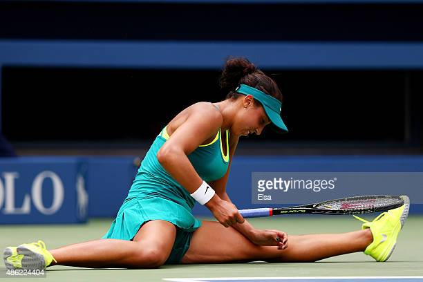 Madison Keys of the United States falls to the court during her Women's Singles Second Round match against Tereza Smitkova of the Czech Republic on...