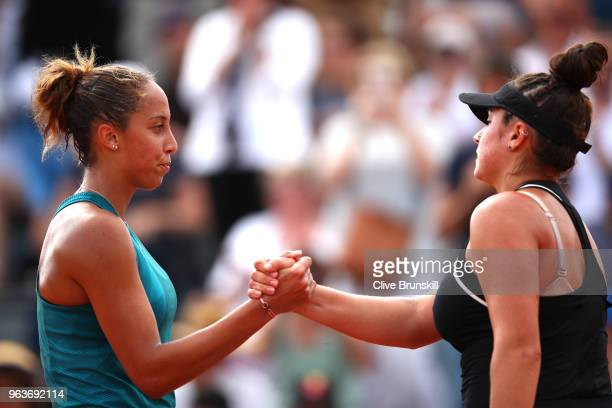Madison Keys of The United States is congratulated on victory by Caroline Dolehide of The United States following their ladies singles second round...