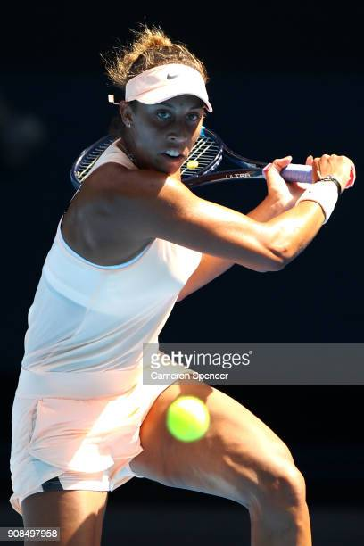 Madison Keys of the United States plays a backhand in her fourth round match against Caroline Garcia of France on day eight of the 2018 Australian...