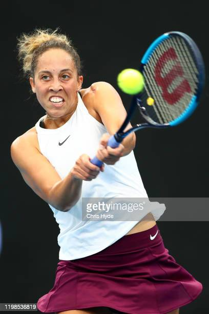Madison Keys of the United States plays a backhand in her match against Danielle Collins of the United States in the quarter final match during day...