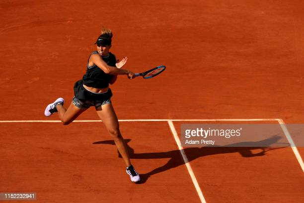 Madison Keys of The United States plays a forehand during her ladies singles first round match against Evgeniya Rodina of Russia during Day three of...