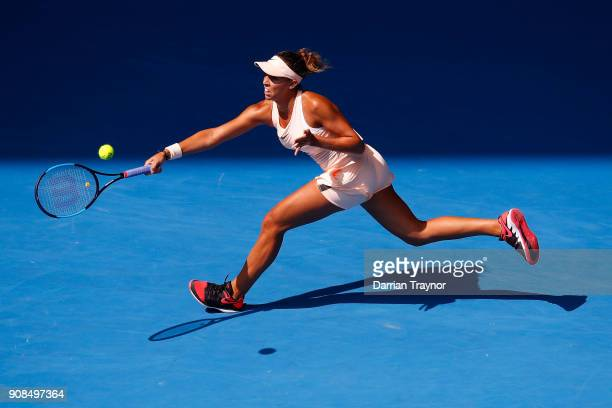 Madison Keys of the United States plays a forehand in her fourth round match against Caroline Garcia of France on day eight of the 2018 Australian...