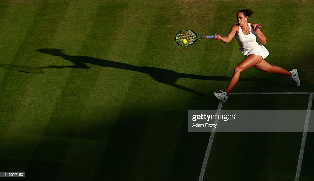 Madison Keys of The United States plays a return during the Ladies Singles third round match against Alize Cornet of France on day six of the Wimbledon Lawn Tennis Championships at the All England Lawn Tennis and Croquet Club on July 2, 2016 in London, England.